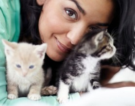 woman with kittens
