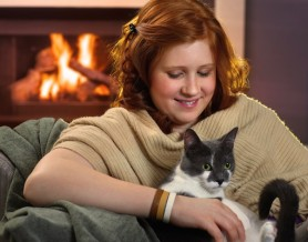 girl holding cat by the fire, pet boarding Melbourne FL
